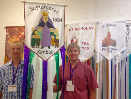 Picture of Luke and Andrew Mairose carrying the St. Margaret's Banner
